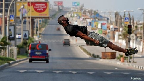 Palestinian athlete Ahmed Abu Hasira demonstrates his parkour skills during a lockdown amid the COVID-19 outbreak in Gaza City.