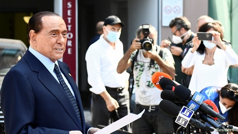 Former Italian Prime Minister Silvio Berlusconi speaks to the media as he leaves Milan's San Raffaele hospital, where he was being treated after testing positive for the COVID-19 and diagnosed with mild pneumonia, in Milan.