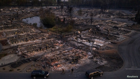 Security officials survey the Bear Lakes Estates neighborhood which was left devastated by the Almeda Fire in Phoenix, Oregon, Sept. 9, 2020.