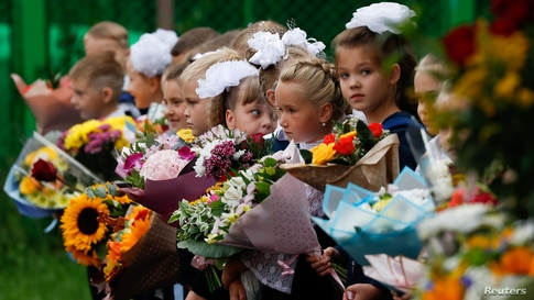 First graders attend a ceremony marking the start of the new school year, as schools reopen after the summer break and the lockdown due to the outbreak of the coronavirus disease (COVID-19), in Moscow, Russia.