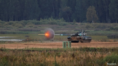 A T-72 B3 tank operated by a crew from Uzbekistan fires during the Tank Biathlon competition at the International Army Games 2020 in Alabino, outside Moscow, Russia, Sept. 2, 2020.