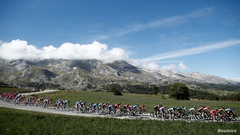 The peloton rides during the fourth stage of the Tour de France cycling race over 160,5 kilometers (99,7 miles) with start in Sisteron and finish in Orcieres-Merlette, southern France.