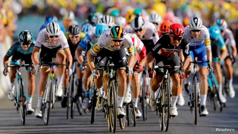 Deceuninck-Quick Step rider Sam Bennett of Ireland and Lotto Soudal rider Caleb Ewan of Australia sprint toward the line during the stage ten of the Tour de France cycling race from Ile d'Oleron to Ile de Re in France.