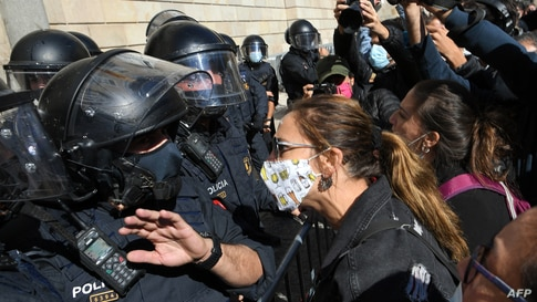 Demonstrators protest in front of Catalan regional police during a demonstration on October 16, 2020 in Barcelona to protest…