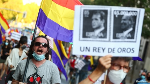 A protester shouts slogans during a demonstration against the Spanish monarchy amid allegations of corruption.
