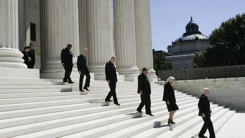 Associate justices walk down the steps of the Supreme Court as they wait for the casket carrying Chief Justice William H. Rehnquist to arrive, Sept. 7, 2005 in Washington.