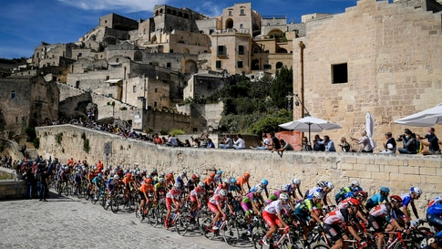 The pack of cyclists pedals past Matera at the start of the seventh stage of the Giro d'Italia cycling race, from Matera to…