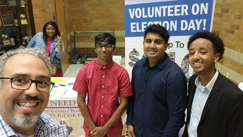 Rohan Rajesh, (second right) with fellow students and Gilberto Zelaya, vice president of the Montgomery County Board of Elections (far left), at Clarksburg High School in Clarksburg, Maryland, October 2019. (Photo courtesy of Rohan Rajesh)