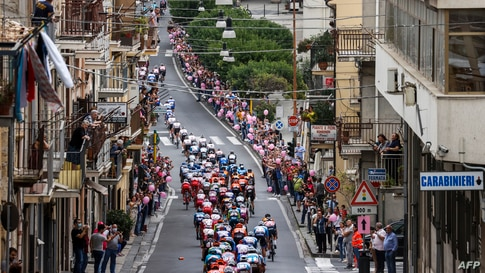 The pack rides through the town of Agira during the 3rd stage of the Giro d'Italia 2020 cycling race, a 150-kilometer route between Enna and volcano Etna, Linguaglossa-Piano Provenzana, Sicily, Italy.