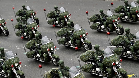 Taiwan's military police perform during the National Day in front of the Presidential Office in Taipei, Oct. 10, 2020.