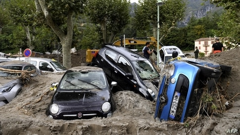 A pile of vehicles are seen on a street in Breil-sur-Roya, south-eastern France after extensive flooding caused widespread damage.