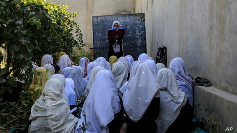 Afghan students attend an open air class at a primary school in Kabul.