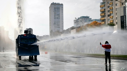 Police use a water cannon against demonstrators during a rally in Minsk, Belarus.