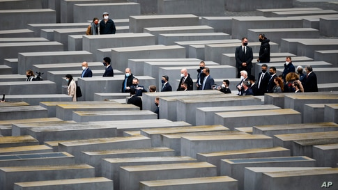 German Foreign Minister Heiko Maas, gesturing at center, visits the Holocaust Memorial in Berlin with his counterparts from Israel Gabi Ashkenazi, below 4th right from center, and Sheikh Abdullah bin Zayed Al Nahyan from the UAE, 2nd right from center.