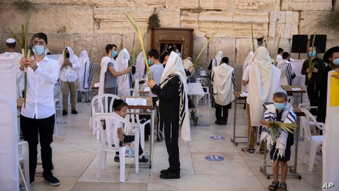 An ultra-Orthodox Jewish man prays during the Jewish holiday of Sukkot at the Western Wall, the holiest site where Jews can pray in Jerusalem's Old City.