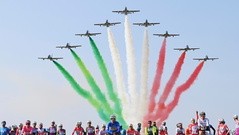 The Frecce Tricolori Italian Air Force aerobatic squad flyingat the Rivolto air base prior to the 15th stage of the Giro d'Italia cycling race in Italy.