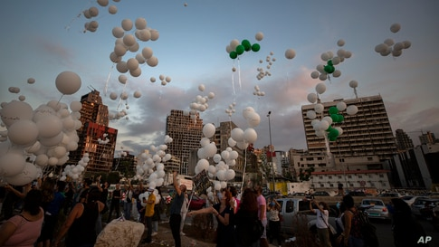 People release scores of white balloons bearing the names of the Aug. 4 deadly explosion during the two-month anniversary, next to the seaport of Beirut, Lebanon, Oct. 4, 2020.