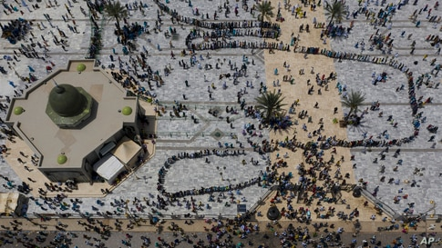 In this aerial photo, pilgrims from the Mouride Brotherhood arrive at the Grand Mosque of Touba during the celebrations of the Grand Magal of Touba, in Senegal, Oct. 6, 2020.