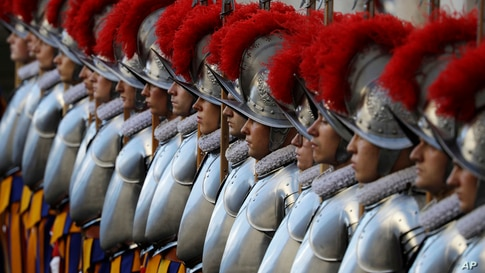 Swiss Guards stand attention at the St. Damaso courtyard on the occasion of the swearing-in ceremony at the Vatican.