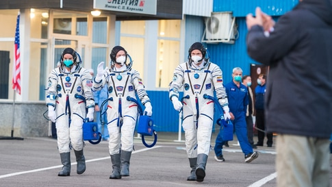 Expedition 64 NASA astronaut Kate Rubins, l, and Russian cosmonauts Sergey Ryzhikov, center, and Sergey Kud-Sverchkov, r, head to their launch onboard the Soyuz MS-17 spacecraft, at the Baikonur Cosmodrome in Kazakhstan.