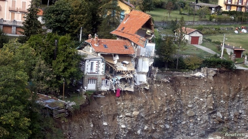 An aerial view shows damaged houses in Saint-Martin-Vesubie, southern France, as clean-up operations continue after storm Alex hit the Alpes-Maritimes department, bringing record rainfall and causing heavy flooding.