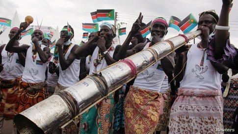 Civilians celebrate the signing of peace agreement between the Sudan's transitional government and revolutionary movements to end decades-old conflict, in Juba, South Sudan, Oct. 3, 2020.