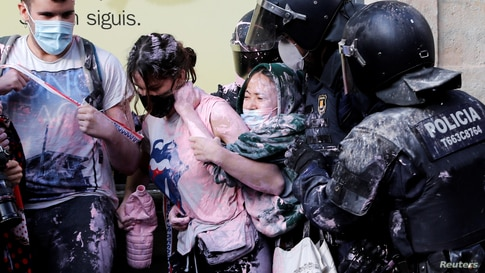 Anti-eviction protesters scuffle with police to prevent eviction of a family from their home at Las Ramblas in Barcelona, Spain.