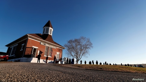 Voters line up at the Trenton Town Hall during Election Day in Trenton, Wisconsin, Nov. 3, 2020.