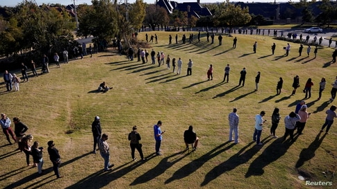Voters wait in a long line to cast their ballots at Church of the Servant in Oklahoma City, Oklahoma, Nov. 3, 2020.