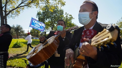 A Mariachi band play outside of a polling site on Election Day in Houston, Texas, Nov. 3, 2020.
