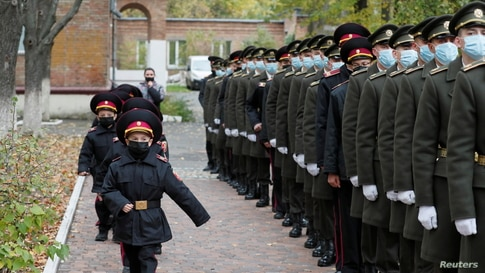 Young military march for a ceremony of receiving their shoulder marks in Kyiv, Ukraine November 6, 2020. REUTERS/Gleb Garanich …