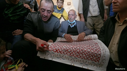 Freed Palestinian prisoner Abdel-Raouf Qe'dan, who has been released after serving a 16-year-sentence in an Israeli jail, marks…