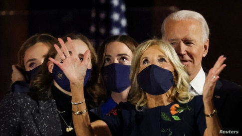 Democratic 2020 U.S. presidential nominee Joe Biden is accompanied on stage by his wife Jill and his granddaughters.