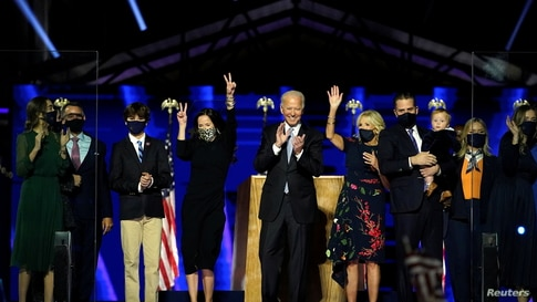 Democratic 2020 U.S. presidential nominee Joe Biden is accompanied on the stage by his wife Jill, and members of their family.