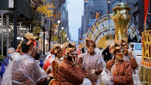 Participants gather ahead of the 94th Macy's Thanksgiving Day Parade closed to the spectators due to the spread of COVID.