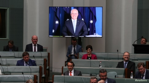 Australia's Prime Minister Scott Morrison appears via videoconference from his quarantine at the Lodge, during Question Time in…