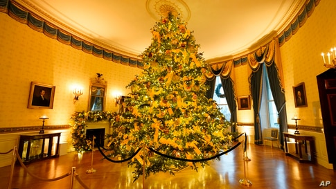 The Blue Room of the White House is decorated during the 2020 Christmas preview, Monday, Nov. 30, 2020, in Washington. (AP…