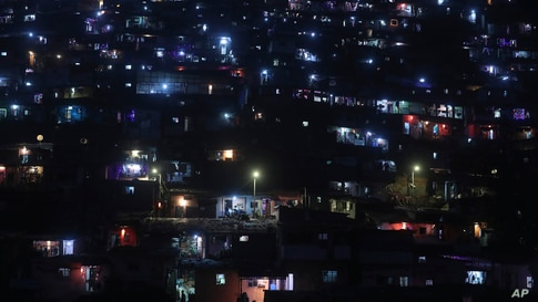A slum colony is decorated with lanterns and lights as they celebrate Diwali, the Hindu festival of lights, in Mumbai, India,…