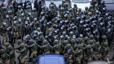 Law enforcement officers gather to disperse opposition supporters during a rally to protest against the Belarus presidential election results in Minsk, Belarus.