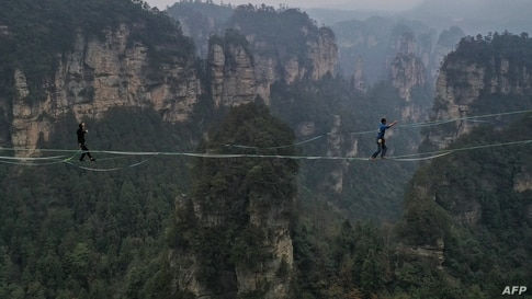 Contestants participate in a slackline contest in Zhangjiajie, in central China's Hunan province.