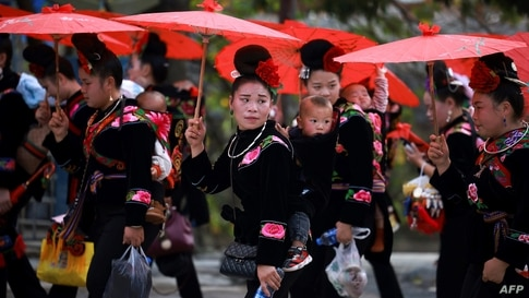 Women of the Miao ethnic minority in traditional costumes parade to celebrate the Miao new year festival in Leishan county, in China's southwestern Guizhou province, Nov. 18, 2020.