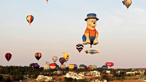 Some of the 100 hot air balloons that participate in the International Hot Air Balloon Festival, fly over Leon, Guanajuato state, Mexico, Nov. 14, 2020.
