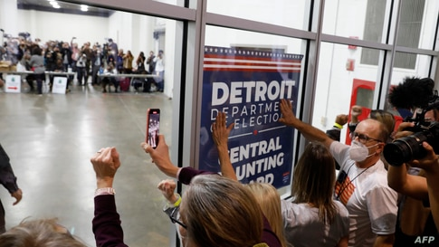 Supporters of U.S. President Donald Trump bang on the glass and chant slogans outside the room where absentee ballots for the 2020 general election are being counted at TCF Center in Detroit, Michigan, Nov. 4, 2020.