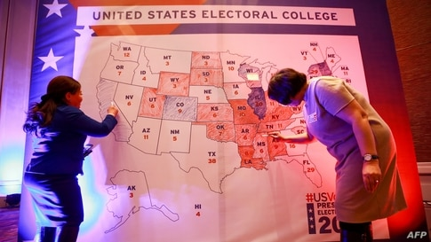 People color an electoral map during a U.S. presidential election watch party at the U.S. embassy in Ulaanbaatar, the capital of Mongolia.