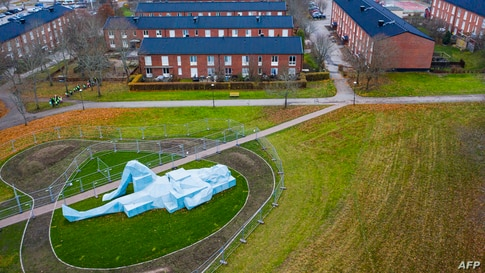 """This aerial view photo shows one of two """"Varbergs Giants"""", a giant sculpture by French artist Xavier Veilhan displayed in Varberg, south of Stockholm, Sweden."""