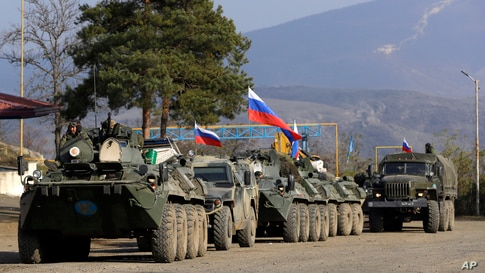 Military vehicles of Russian peacekeepers are seen at a check point on the road to Shusha in the separatist region of Nagorno-Karabakh.