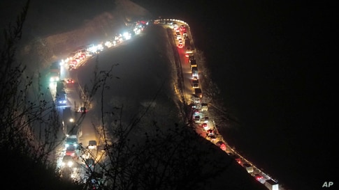 Cars and trucks stuck in a huge traffic jam are seen on the road from Kalbajar to a mountain pass leaving the separatist region of Nagorno-Karabakh to Armenia, Nov. 14, 2020.