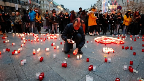 People light candles during the celebrations of the 31st anniversary of the pro-democratic Velvet Revolution that ended communist rule in 1989, in Prague, Czech Republic.