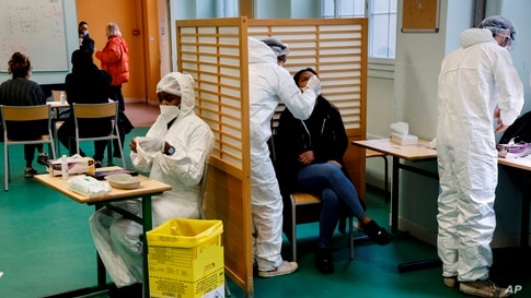 A student of the Emile Dubois high school takes part in a COVID-19 antigen test in Paris, France Nov. 23, 2020.