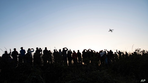 Hundreds of people watch and photograph the Airbus of the French airline Air France taking off from Tegel (TXL) airport in Berlin, Germany. Tegel Airport closes with the departure of the last scheduled flight number AF 1235 to Paris.